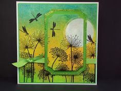 handmade card from Lavinia Stamps Blog ... impressionistic sunrise scene with drangonflies and silhouette flowers ...