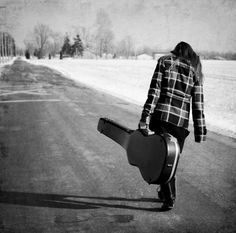 She went with her battered guitar, telling of dreamers, and wanderers, and storytellers.