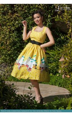Pinup Couture- Aurora Dress in Mary Blair Train Border Print | Pinup Girl Clothing