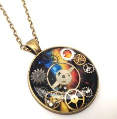 Steampunk antique bronze nebula pendant with real cogs set in resin handpainted and made gift by ResinHead on Etsy