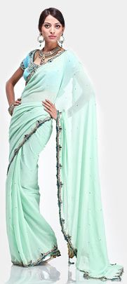 a blouse centric saree in aqua green color with a delicate ornamental border on georgette fabric. Light turquoise crepe blouse with intricate zardozi work accentuated with stones.