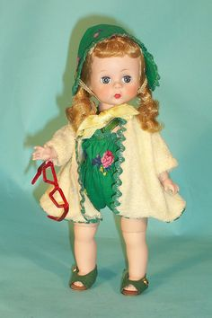 American Princess Doll - Wendy is well- dressed for the beach (circa 1957) in a garden green printed sunsuit, matching sunbonnet and a soft yellow terry beach coat. Her protective eye gear and sandals accessorize