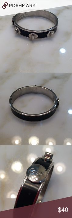 Coach Silver and black bangle Coach silver and black bangle with button opening and three silver screw top decals Coach Jewelry Bracelets