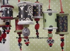 damask print ribbon the width of the spools, combined with some narrow ribbon in assorted Christmas prints as accent and as the hanger, beads, clear beading cord and Aleene's tacky glue