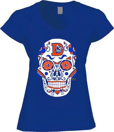 Broncos Sugar Skull - Art by Jeremy Nash. These shirts are a fasion fit, and do run small. Please refer to the size chart before ordering to ensure a great fit.  100% ring-spun combed cotton, 36 singles 3.7 ounce jersey knit deep v-neck t-shirt. Fabric is laundered for extreme softness, stretch memory and reduced shrinkage. Set-in collar of 1x1 baby rib. Side-seamed with longer body length and fashion fit  4 AFA Logo on the back  This is original artwork and protected under US Copyright law…
