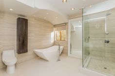 Modern and minimalist, this bathroom has both a walk in shower and a free standing soaking tub. 6136 W. 5th St | Beverly Grove