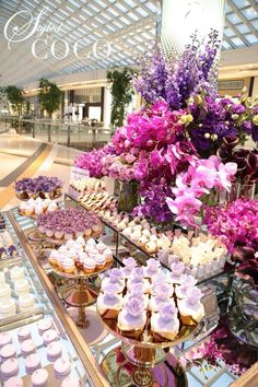 Champagne Soirée created for Anton Jewellery. Gorgeous bright blooms in fushia and purple hues. Floral arrangements phalenopsis orchids, peonies, Vanda orchids, roses.