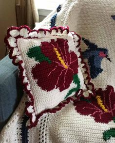 Watch the product review video for this gorgeous Hummers and Hibiscus Afghan and Pillows Crochet Pattern! Design by: Mary Pueschner Skill Level: Intermediate Size: Afghan: 52″ long x 45″ wide; Pillows