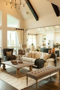 Traditional Living Room with High ceiling, Restoration hardware 17th c. monastery coffee table, Hardwood floors, Chandelier