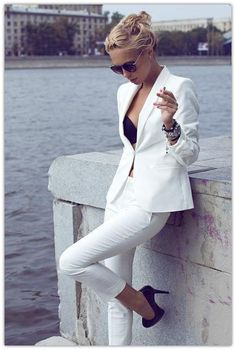 Badass  in an all-white suit, black bra + pumps | suit up