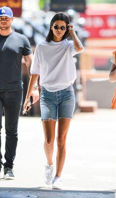 white oversized tee and long denim shorts