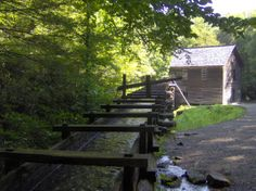 Mingus Mill and flume, near Oconaluftee in the Great Smoky Mountains. The flume transports water from Mingus Creek to the mill's turbine. The mill was constructed in 1886 by Sevier County, Tennessee millwright Sion Thomas Early for John Mingus, the son of the area's first Euro-American settler. (Brian Stansberry, photographer)