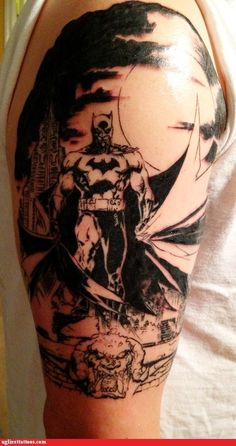 Awesome Batman arm tattoo. Almost looks like it was taken from an early B comic book panel.