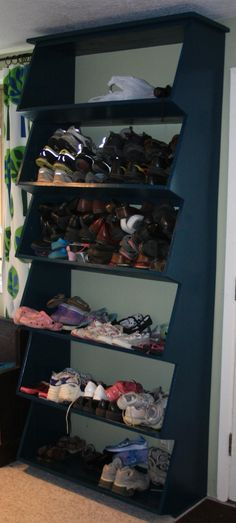 I need need need this in my basement! :Floor-to-ceiling Shoe Shelf with Angled Front Shelf