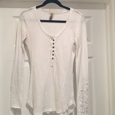 Long sleeve white Free people shirt Vintage low cut style with beautifully knit sleeves. 100% cotton. Made in India Free People Tops Tees - Long Sleeve