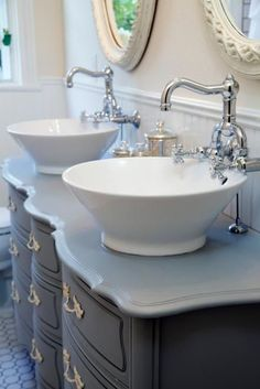 We'd argue the reno's standout feature is the vanity — Chip and Jo revived an old dresser, giving it a fresh coat of paint in a warm gray, then added two vessel sinks with old-fashioned hardware. To top it all off, they hung a pair of ornate wood mirrors above the vanity. See more amazing designs from this episode.