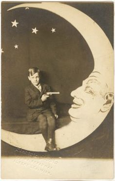I LOVE old paper moon photos - maybe without the gun, though...