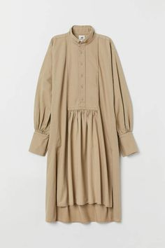 Shirt dress in linen and cotton twill. Stand-up collar, bib front with button placket, heavily dropped shoulders, and wide, full sleeves Hijab Fashion, Fashion Outfits, Minimal Dress, Mode Abaya, Hijab Stile, Dress Stand, Twill Shirt, Body, Designer Dresses