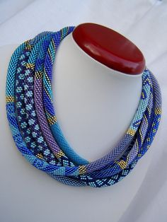 """Denim"" bead crochet rope necklace by Venge on biser.info. It's a single rope 2.25 metres long, 8 beads around, ""dortak"" thread №30, 0.9 hook, Toho 11 seed beads in more than 30 shades of blue, plus purple and 2 golds - PF557 and 22."