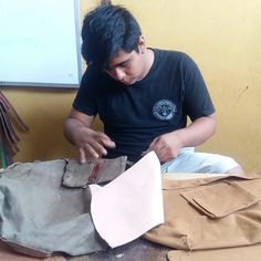 Fredy is back!  Shown here building a duffel bag.