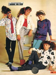 First shirt on the left... yeah I had it. I wore it with stirrup pants and a pink belt. I was so cool. lol