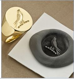 This one is remarkably close to Elodie's ring. Very cool! (Seal Engraved Signet Rings by John W Thompson)