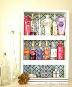 DIY Perfume & Lotion Tower from thrifty and chic. All you need is wood, nail gun, fabric and ribbons. sounds simple enough...time to invest in a nail gun. :)