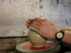 Throwing a clay pottery bird feeder on a potters wheel demo pot throwing