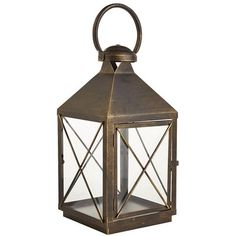"""The name Bennett comes from the Latin <i>Benedictus</i>, or """"blessed."""" A fitting choice, we think, for our exclusive iron lantern. It's painted by hand and finished with a powder coating for rust-resistance, which makes it a timeless way to light up an evening. Just place your favorite 3x4 pillar inside, and you're good to go."""
