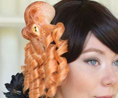 Turn yourself into a fashion icon by pioneering your own zany nautical style using these octopus hairpieces. Each of these one of a kind hairpieces comes shaped like a brightly colored cephalopod made entirely out of synthetic hair.