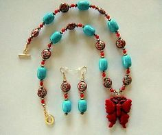 Turquoise and Red Coral Necklace with Red Hand Carved Cinnabar Butterfly Pendant and Vintage Handmade Red Floral Cloisonne Coin Beads by JewelrybyIshi on Etsy, $225.00