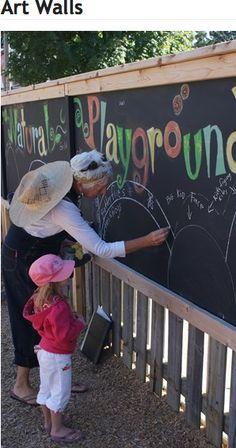 a chalkboard on the fence...it would be better if it were a little lower