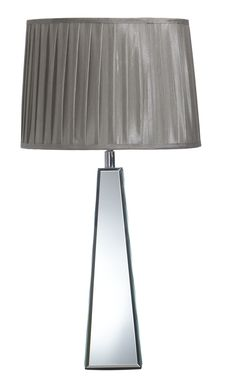 The Aphrodite table lamp embodies contrasting texture in its own right, with a sleek and shiny metal base paired with a pleated taffeta shade in sepia. Price $149.