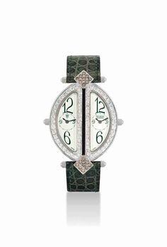 The royal diamond. An 18K white gold, diamond and brown diamond-set oval dual time wristwatch. circa 2000. #watch #ChristiesWatches