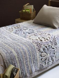 gorgeous crochet bed spread. Just love the flower insert.