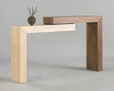 """Stepped table in walnut and maple, measuring 12"""" deep, 36"""" tall and 60"""" long."""