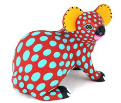 This oaxacan animal wood carving is shown as a koala. Its design mainly incorporates bright blue polka dots in contrast to the dark orange base color. 3d Fantasy, Mexican Folk Art, Animal Sculptures, Art Plastique, Wood Sculpture, Art Education, Oeuvre D'art, Wood Art, Art Lessons