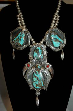 Huge Outstanding Gorgeous Navajo Kakiki Stunning Turquoise And Coral Squash Blossom Pendant Feather Necklace 232 Grams by navajodreams on Etsy