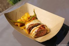United Kingdom Pavilion - The Buttercup Cottage - Pork and apple sausage roll with house-made piccalilli