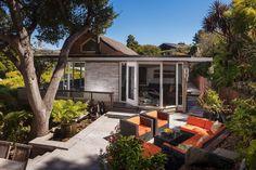 The remodeled Midcentury hosts large windows and a wraparound patio. Photo: Jacob Elliott Photography