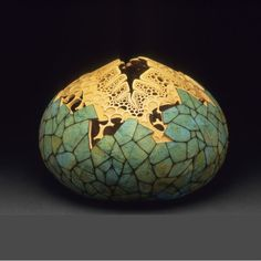 """Egg"" 16""h x 20""w x 12""d. Carving by Mark Doolittle; paper applique by Kathy Doolittle. George Post, photography."