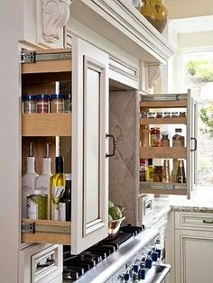 Oil, sauce n spice storage. I like how it is in the support pillars of the range hood- invisible but convenient