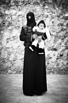 """Sebastiano Tomada Piccolomini, Fadwa, 20 years old, widow with 3 children: """"My husband died on the front lines, I will die on the front lines, may God help us.""""Portraits of an All-Female Fighting Unit of the Free Syrian Army"""