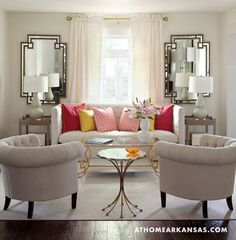 All White Rooms: This all white living room comes alive with vibrant pops of color.