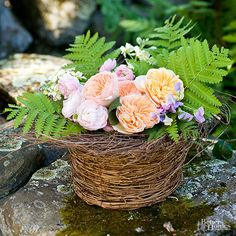 Give Mom a Mother's Day flower arrangement that signals appreciation for her gift of life.  Wire a wreath to the top of a round twig basket to get the look of a bird's nest. Instead of eggs, fill the center with roses and ferns arranged in water-soaked florist's foam and moss./