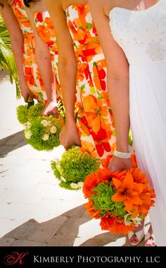Bridesmaids  -  I love the patterns. Great dresses for a tropical wedding.