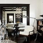 living rooms - black white dark espresso wood floors brown wood accent chair black painted fireplace black door molding ornate mirror black built-ins bookshelves doily white walls paint color living room