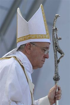 Pope Francis holds his papal crucifix during the World Youth Day's closing Mass on the Copacabana beachfront in Rio de Janeiro, Brazil, July 28, 2013. Francis has spent the week emphasizing a core message: of the need for Catholics, lay and religious, to shake up the status quo, get out of their stuffy sacristies and reach the faithful on the margins of society or risk losing them to rival churches. (AP Photo/Luca Zennaro, Pool)