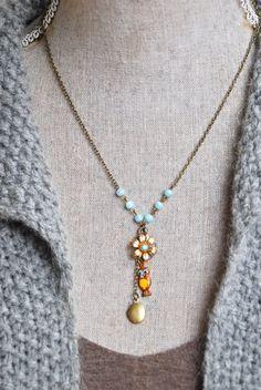 Prissy...   was cute as a button  features vintage glass beads,vintage enamel owl charm,vintage brass locket,vintage swarovski crystal flower