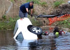 Woman dies after car plunges into creek.
